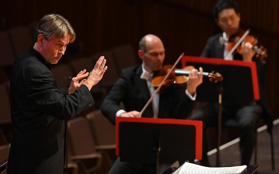 Conductor Esa Pekka Salonen on stage during a concert