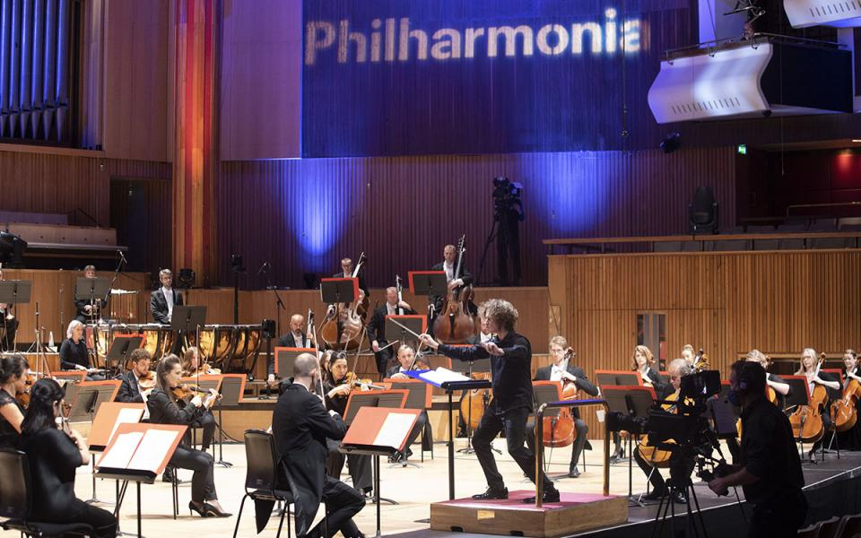 Conductor Santtu Matias Rouvali and the Philharmonia on stage at the Royal Festival Hall