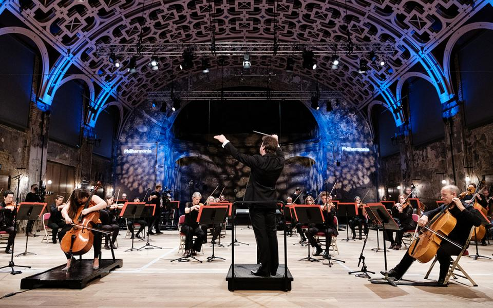 Conductor Jakub Hrusa conducts the Philharmonia a the Battersea Arts Centre in a socially distanced performance