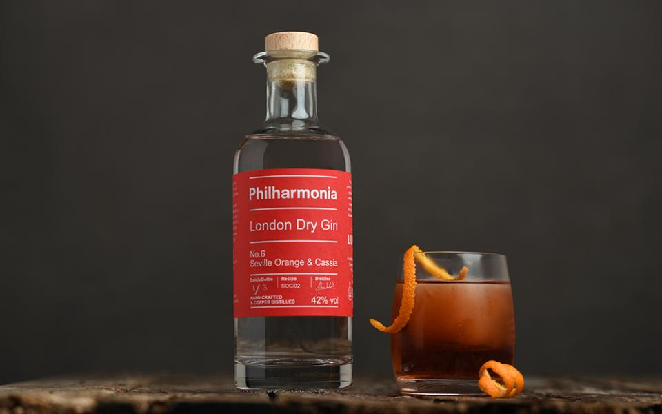 A bottle of Philharmonia Gin next to a cocktail glass