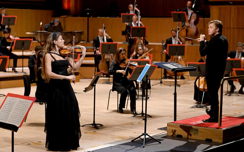 Violinist Nicola Benedetti and conductor Pekka Kuusisto onstage with the Philharmonia at the Royal Festival Hall
