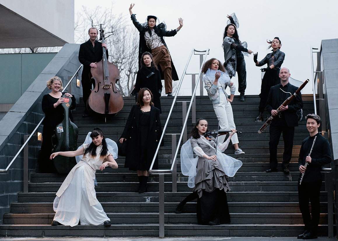 House of Absolute, the Philharmonia's Artist in Residence 2021, on the stairs of the Southbank Centre, alongside players of the Philharmonia