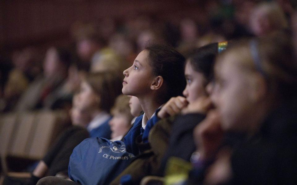 Children listening to a concert