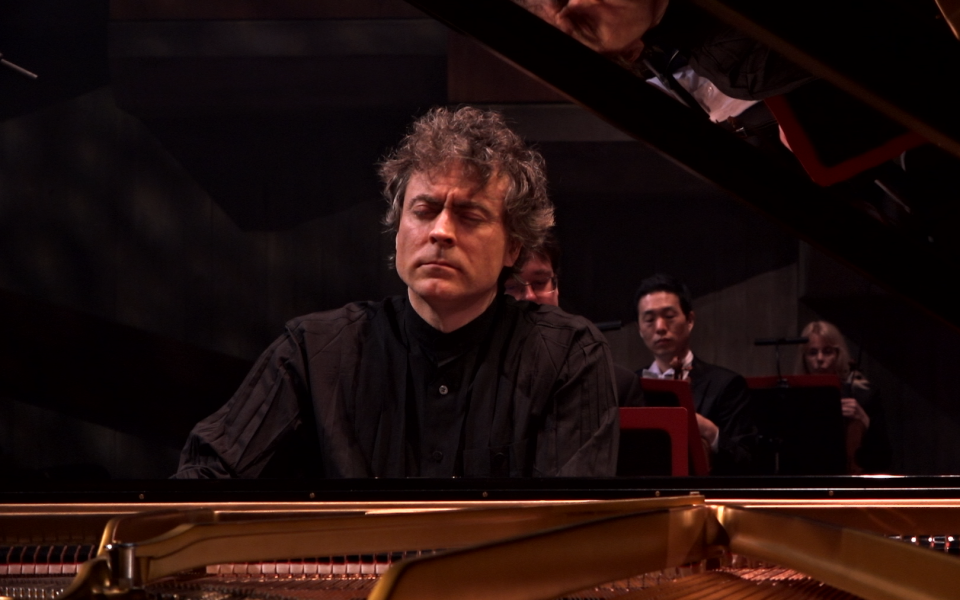 Paul Lewis playing the piano