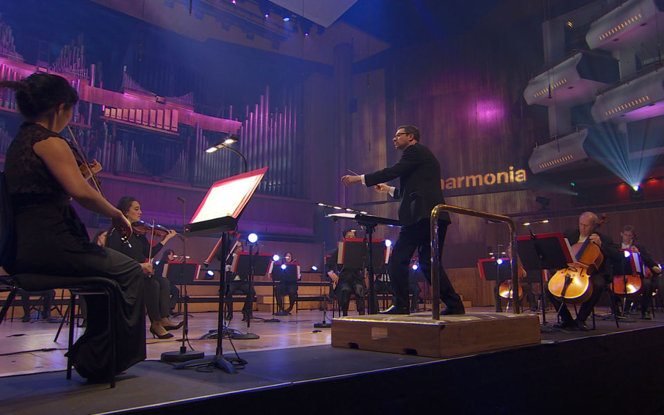 The Philharmonia onstage during a performance conducted by John Wilson