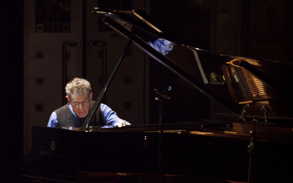 Minimalist composer Philip Glass at the piano.